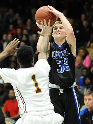 Brookfield Central's Gage Malensek puts up a three-point shot in a game against Milwaukee Vincent.