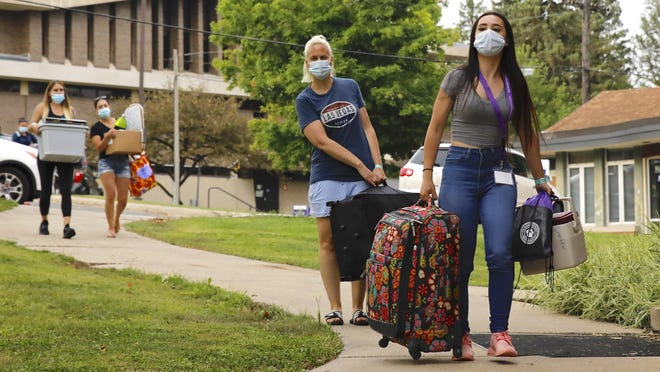Lola Marchese, right, receives help from her aunt, Kelly Smolen, both of Chicago, while moving into her dorm room Saturday, Aug. 15, 2020, at Rockford University.
