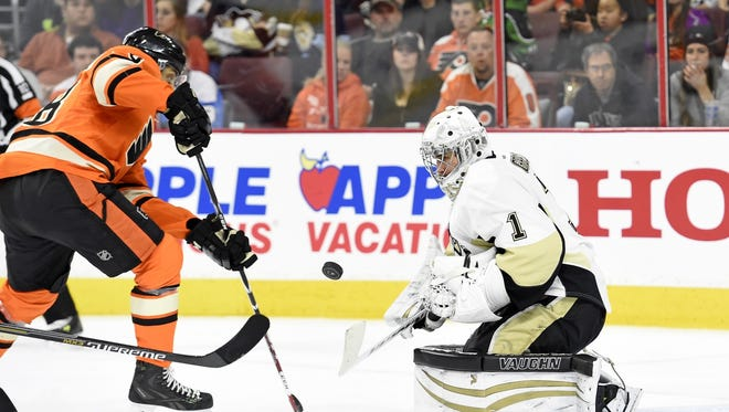 Flyers right wing Pierre-Edouard Bellemare (78) shoots the puck against Pittsburgh Penguins goalie Thomas Greiss (1) during the second period at Wells Fargo Center.