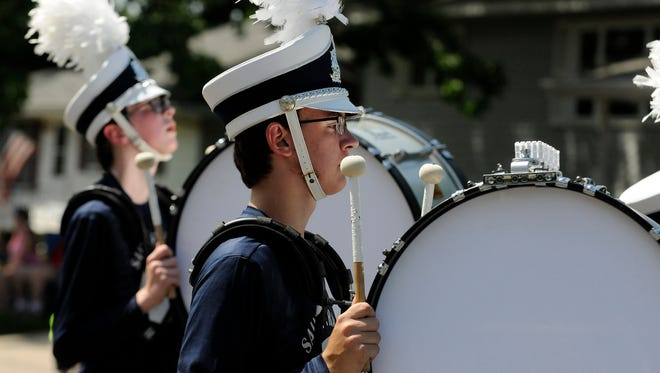 A drummer from the St. Francis Marching Saints marches on in the Sartell SummerFest parade on Saturday, June 11th