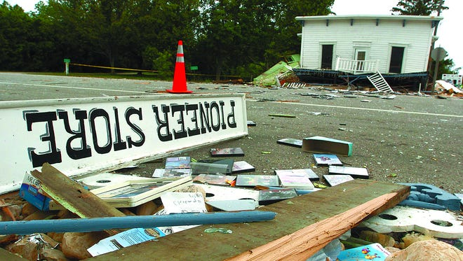 The landmark Pioneer Store in Ellison Bay is destroyed by an explosion July 10, 2006. Debris from the store is scattered across Wisconsin 42.