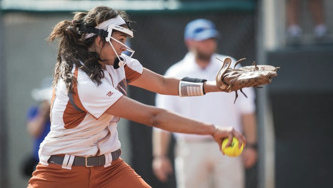 Beeville's Saleen Flores winds up to pitch during a Class 4A state semifinal against Krum at McCombs Field in Austin on Thursday, June 1, 2017.