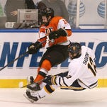 RIT defenseman Brady Norrish moves the puck out of the zone in Friday's semifinal game against Canisius.
