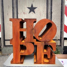 """A steel version of Robert Indiana's HOPE sculpture is displayed outside his home on the first annual """"International HOPE Day his 86th birthday, Saturday, Sept. 13, 2014, on Vinalhaven Island, Maine."""