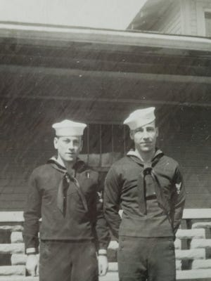 Carl Kidwell (left) and brother Logan Kidwell both served together in the U.S. Navy on the U.S.S. Quincy during World War II. Carl was transferred off the ship before it was sunk during the Battle of Guadalcanal. Logan was killed and his body never recovered.