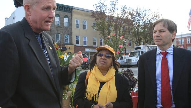 Fair housing activists Jim Killoran, Lena Anderson and Alexander Roberts at the Harrison train station parking lot in October.