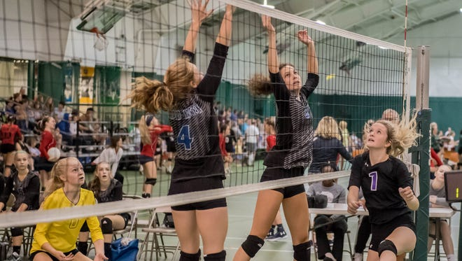 Harper Creek players during the 2017 Carrie Adams Volleyball Tournament on Saturday.