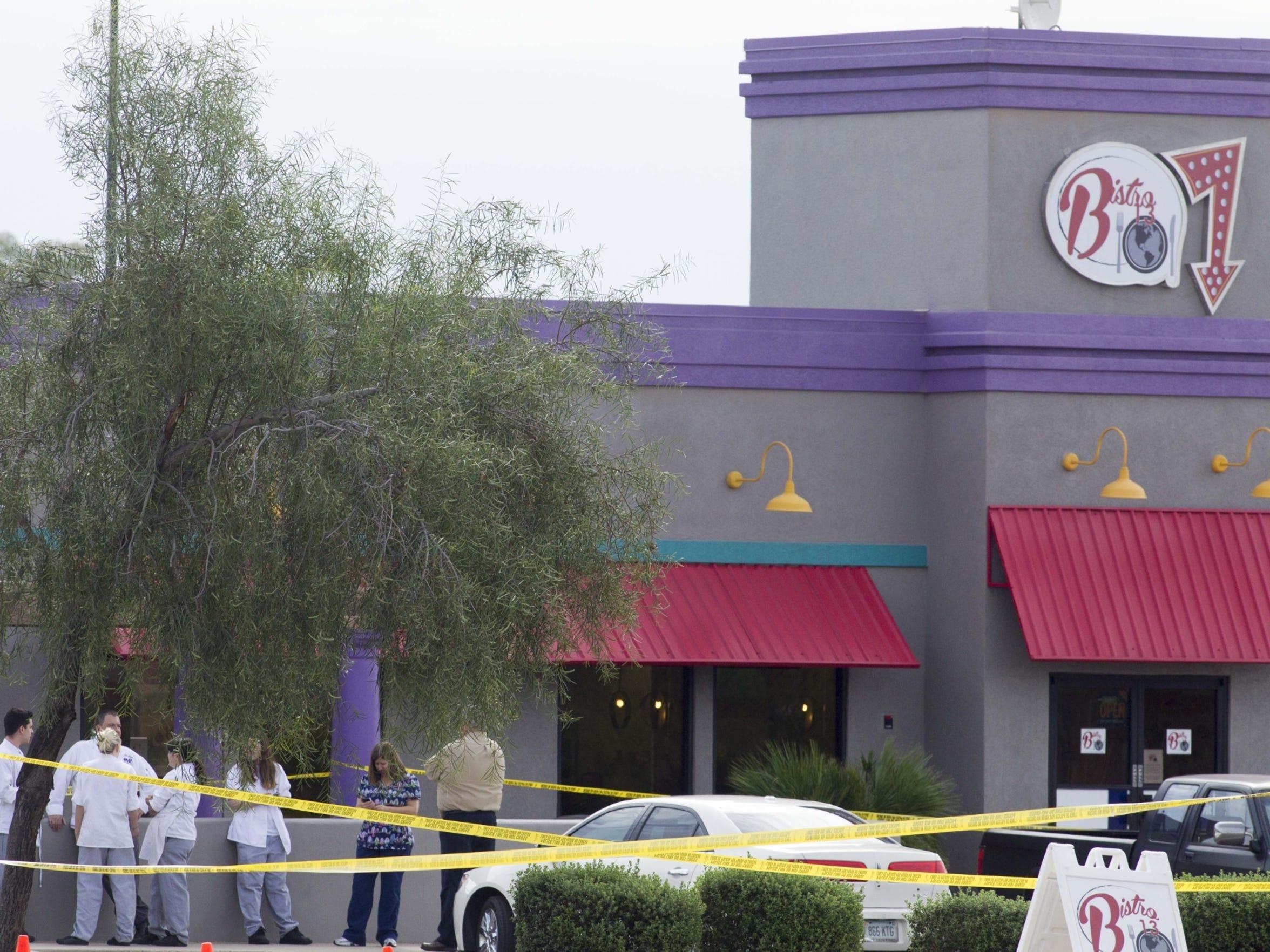 Mesa officials seal off an area after a shooting near
