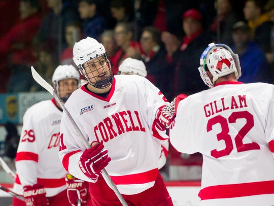 Cornell's Dwyer Tschantz, center, celebrates a goal