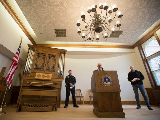 University of Wisconsin - Stevens Point Chancellor Bernie Patterson, center, speaks to the media with Stevens Point Police Department assistant chief Tony Babl, left, and director of protective services, Bill Rowe, right, in the Founders Room at Old Main, Friday, March 18, 2016.