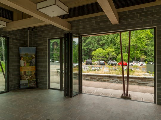 The new visitors center at the overlook at Taughannock Falls State Park opens to the outside on three sides.