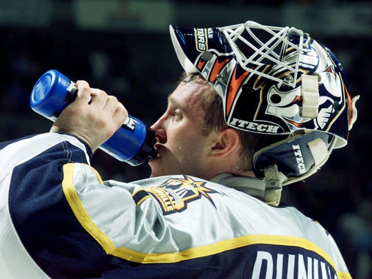 Predators' goalie Mike Dunham takes a water break during