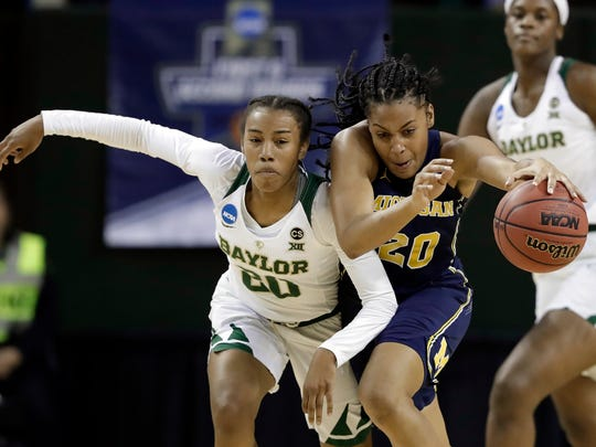 Baylor's Juicy Landrum, left, chases after Michigan's Deja Church during the 2018 NCAA Tournament.