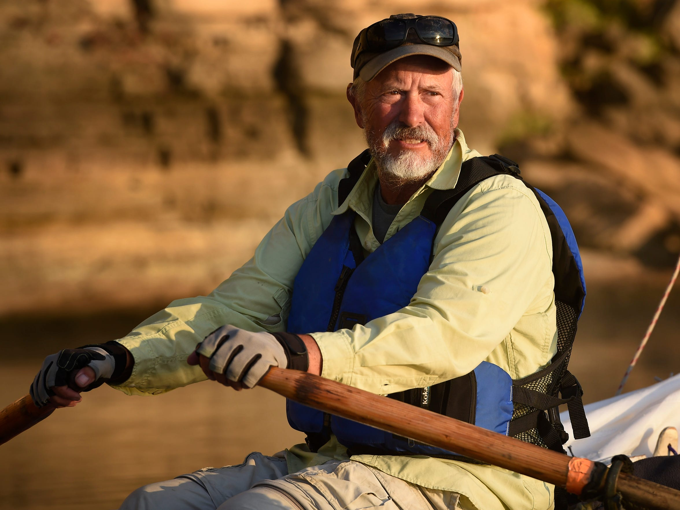 John Guider rows down the Tennessee River on Oct. 11, 2016, as he retraces the journey John Donelson took as one of the founders of Nashville.
