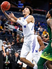 Memphis forward David Nickelberry drive to the basket against the USF defense during first half action of their AAC first round conference tournament game in Orlando, Fl., Thursday, March 8, 2018.