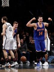 Knicks' Willy Hernangomez (14) and Kristaps Porzingis (6) celebrating after Hernangomez scored as Nets' Bojan Bogdanovic (44) reacts during the second half Wednesday. The Knicks won 95-90.