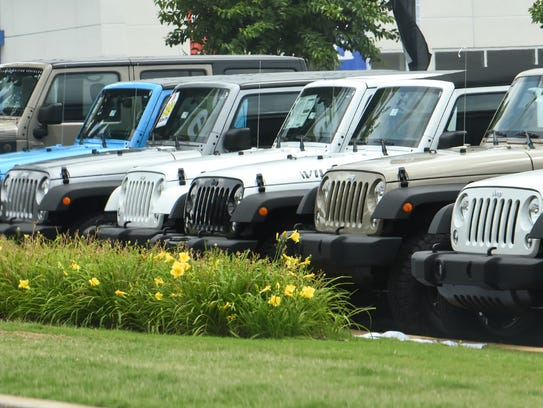 A line of new Jeep cars along Clemson Boulevard in