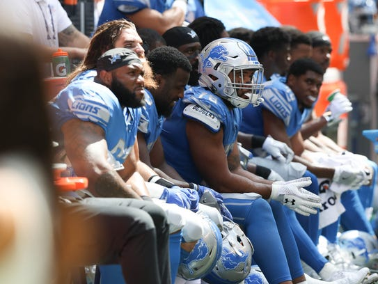 The Lions sit on the sidelines during the third quarter