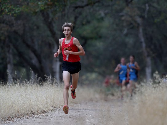 Chico's Charlie Giannini, center, runs in the EAL cross-country championships Thursday at Foothill High School in Palo Cedro.