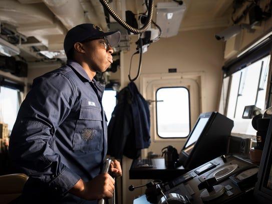 Seaman Najee Williams, 19, from Savannah, Ga., pilots