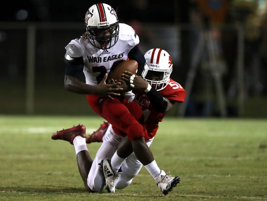 Wakulla's Jordan Bolden tries to break away from Leon's