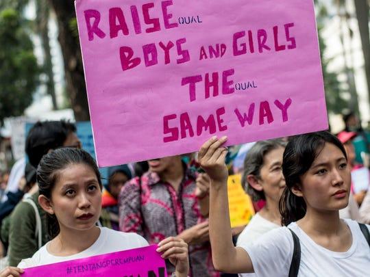 People take part in a  Women's March in Jakarta on