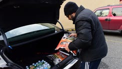 Sunil Sunder Raj, of Oradell, buys two bags of ice