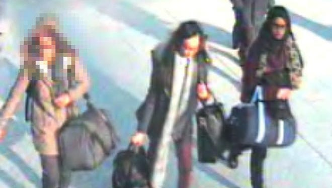 The three girls were at Gatwick Airport, southern England, on Feb. 20.