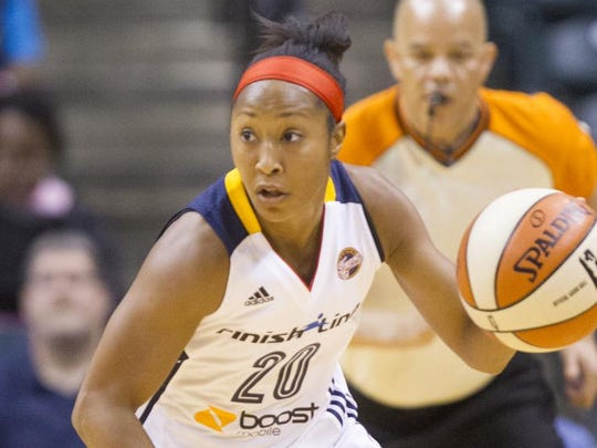The Fever's Briann January brings up the ball against the Washington Mystics during a May 6 preseason game.