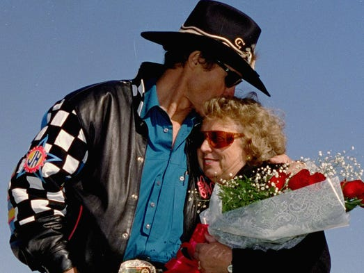 NASCAR driver Richard Petty kisses his wife, Lynda, in 1992, during ceremonies before the start of the final race of his career, at Atlanta Motor Speedway. She died Tuesday after a long battle with cancer. She was 72.