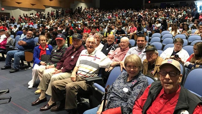 A group of veteran residents from Mirador retirement community made their way to Veterans Memorial High School where they were honored by the school for their sacrifice and service.