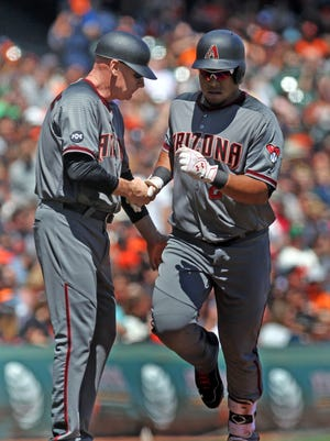 Apr 21, 2016: Arizona Diamondbacks third base coach Matt Williams greets left fielder Yasmany Tomas (24) after his solo home run in the fourth inning of their MLB baseball game with the San Francisco Giants at AT&T Park.