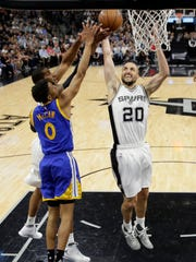 Golden State Warriors' Patrick McCaw (0), San Antonio Spurs' LaMarcus Aldridge, left rear, and Ginobili compete for a rebound during the first half in Game 4 of the NBA basketball Western Conference finals, Monday, May 22, 2017, in San Antonio.