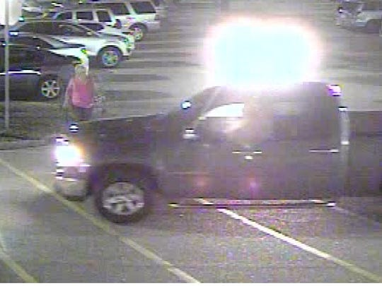 This is a still from surveillance  footage at the Del Prado Boulevard Wal-Mart showing the truck Cape Coral police say was driven by the man who stole two HP desktops from the store.
