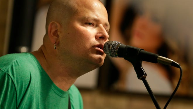 Paul Hanna of Green Bay performs songs from his new solo album at Copper Rock in downtown Appleton during the recent Mile of Music festival.