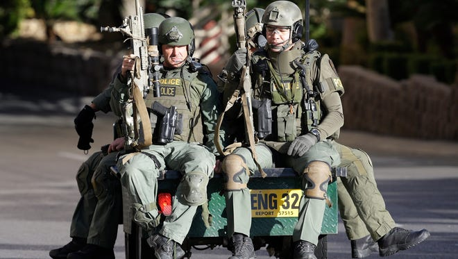 Las Vegas SWAT team members ride on a vehicle at the MGM Grand on Dec. 10. They responded to an incident involving a suicidal man who was found dead in the hotel.