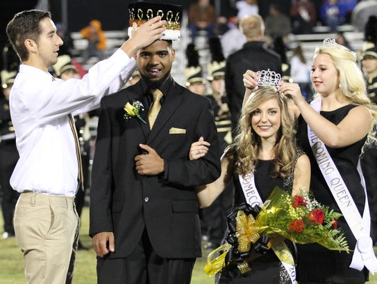 From left, last year's homecoming king Jimmy Adcock