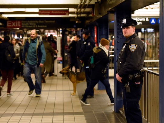 A bolstered police presence Tuesday was one of the few signs in the sprawling Times Square/Port Authority Bus Terminal subway station that anything had taken place there the day before.
