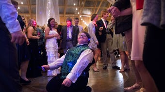 Prom-goers dance during the Union EDGE Program's special needs prom at The Barn at Snider Farms.