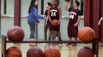 Arlington High School junior Camille Loussedes talks about the unified basketball team at Arlington High School April 12, 2018