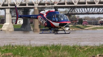 WLKY helicopter hovers over the waterfront lawn to help get it dry in time for Thunder Over Louisville