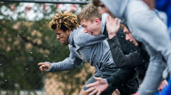 Dowling Catholic's Jayson Murray is proving its possible to find success in both football and track.