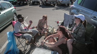 Wind delayed the opening of campsites for Coachella. Festival goers set up in the Indio Walmart parking lot.