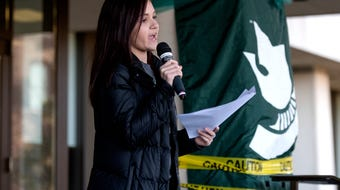 Kaylee Lorincz, a Larry Nassar survivor, speaks during the Rally for Resignations in front of the Hannah Administration Building at Michigan State.