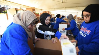 Volunteers packing boxes with foods that will be given to people in need in their local communities, took place at the Islamic Center of Passaic in Paterson on 04/22/18. The goal is to create some 5,000 packaged meals.