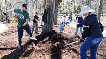 Volunteers help beautify Tibbetts Brook Park for the Pitch in for Parks event April 22, 2018 in Yonkers.