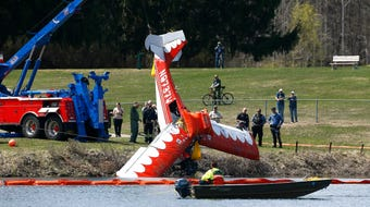 A two-seat Bellanca CH7A that crash landed in the middle of the 119-acre Lake Aeroflex at Kittatinny Valley State Park on Monday morning was towed to a hanger after it was pulled from the water.