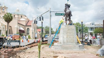 Workers hoist the new Galvez statue into place at the corner of North Palafox and Wright Streets in downtown Pensacola on Tuesday, April 24, 2018.  The official unveiling of the statue will take place on May 8th.