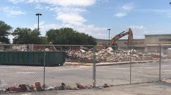The old Zookini's building between Olive Garden and Cotton Patch is a pile of rubble on Wednesday, May 2, 2018, to make way for Raising Cane's.