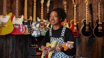 Nashville guitarist Melanie Faye checks out guitars at the Eastside Music Supply shop.
